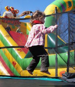child enjoying bounce house rental